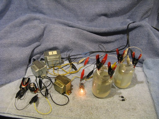 I was curious to see if homemade borax rectifiers (in the two jars) could be used instead of modern silicon rectifiers to increase the gain of the mag amp ...